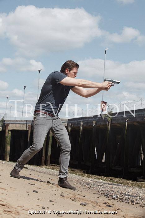 CollaborationJS MAN POINTING GUN ON RIVER BANK Men