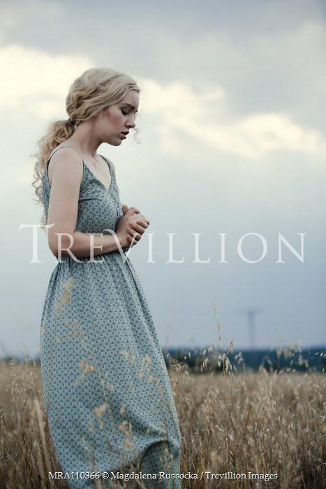 Magdalena Russocka sad blonde woman standing in field