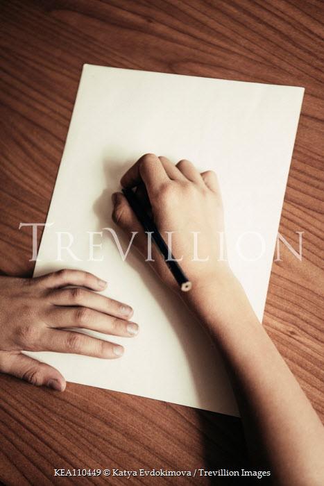 Katya Evdokimova Hand of boy writing on paper Children