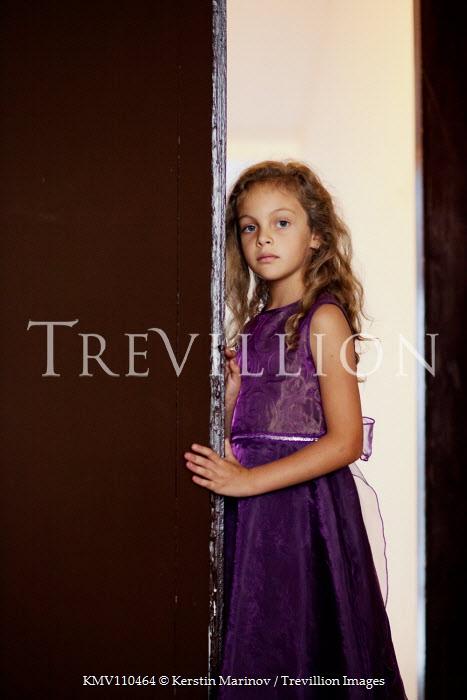 Kerstin Marinov Girl with purple dress in doorway Children