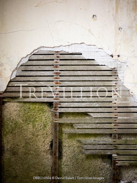 David Baker Wood of broken wall in abandoned house Building Detail