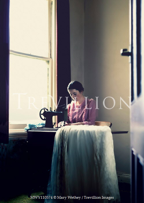 Mary Wethey Woman working at vintage sewing machine Women