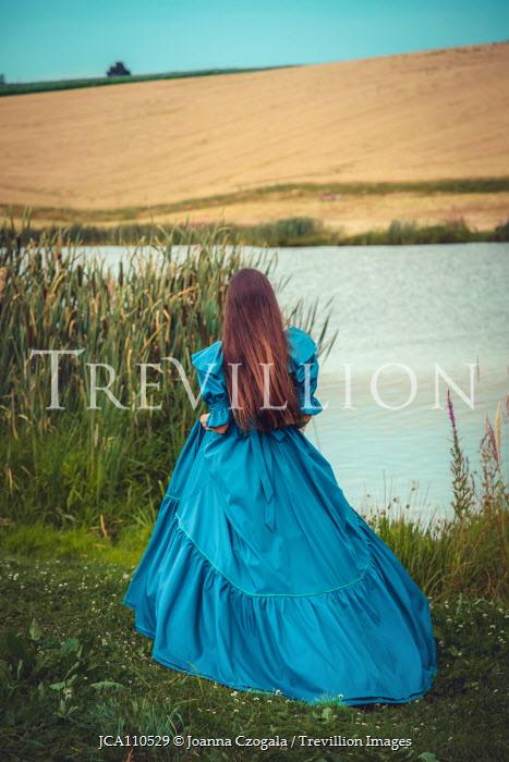Joanna Czogala Young woman in blue dress by river Women