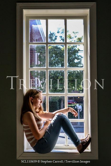 Stephen Carroll TEENAGE GIRL SITTING ON WINDOW SILL Women