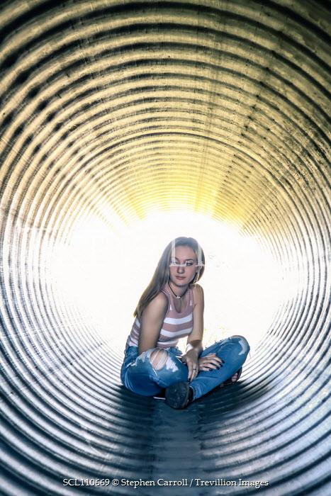 Stephen Carroll TEENAGE GIRL SITTING IN METAL TUBE Women