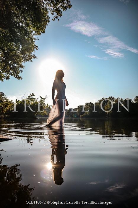 Stephen Carroll WOMAN IN WHITE DRESS WALKING IN WATER Women