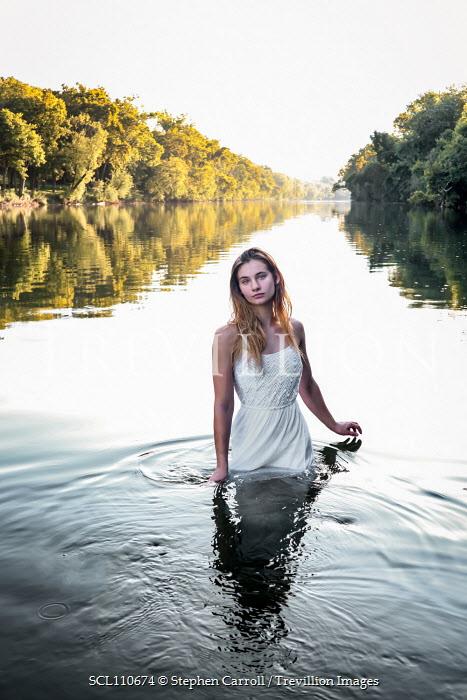 Stephen Carroll WOMAN IN WHITE DRESS STANDING IN RIVER Women