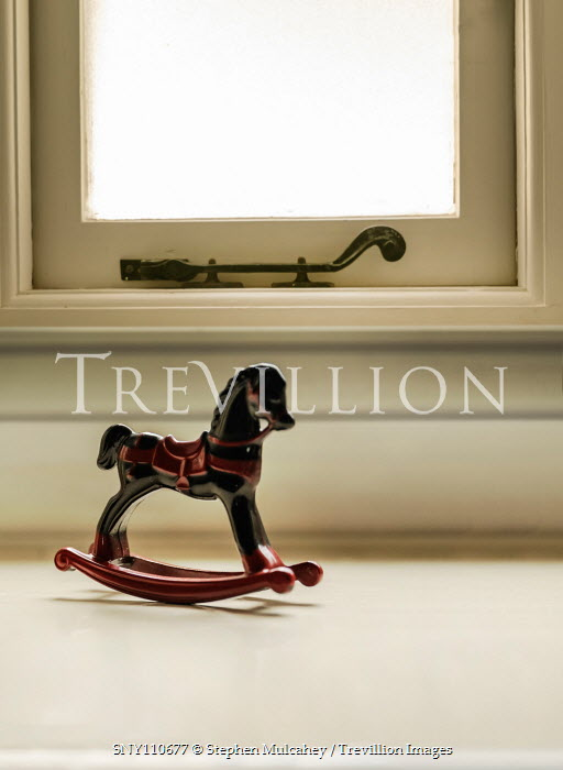 Stephen Mulcahey TOY ROCKING HORSE ON WINDOW SILL Miscellaneous Objects
