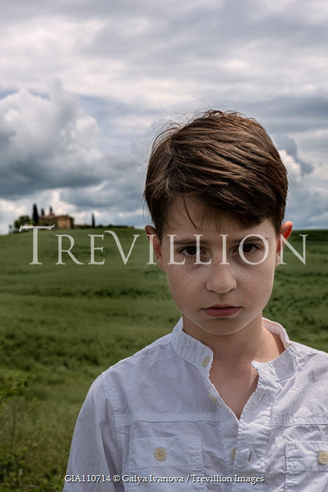 Galya Ivanova CLOSE UP OF SERIOUS BOY IN COUNTRYSIDE Children