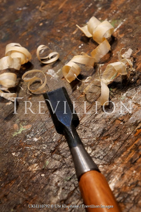 Ute Klaphake WOODEN CHISEL WITH SHAVINGS ON TABLE Miscellaneous Objects