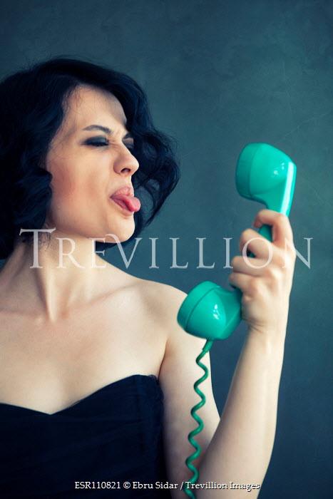 Ebru Sidar WOMAN STICKING TONGUE OUT AT PHONE Women