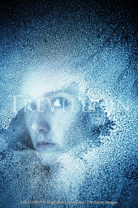 Magdalena Russocka woman looking through frosted window