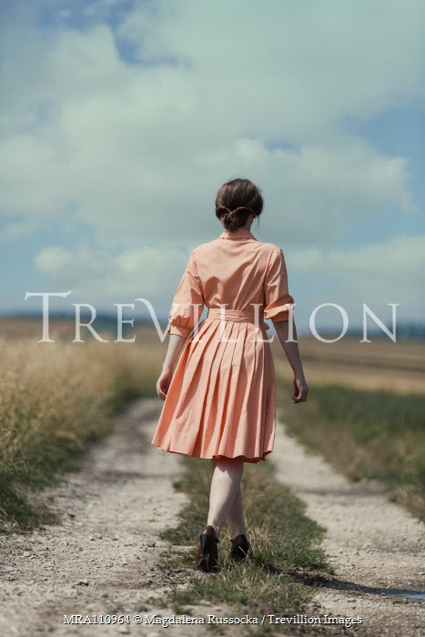Magdalena Russocka retro woman walking in field
