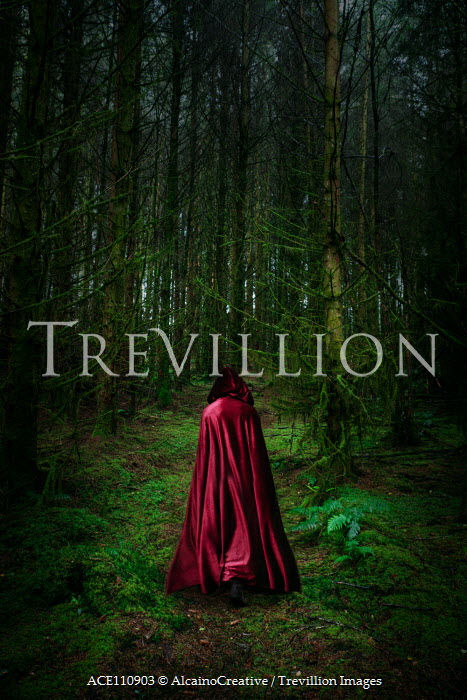 AlcainoCreative Person in red cloak in forest