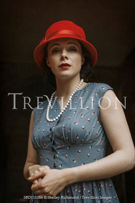Shelley Richmond Young woman in 1940s dress and red hat