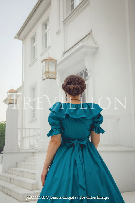 Joanna Czogala HISTORICAL WOMAN OUTSIDE HOUSE FROM BEHIND Women