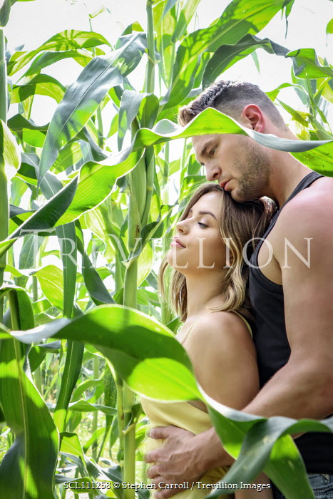 Stephen Carroll COUPLE EMBRACING IN CORN FIELD Couples