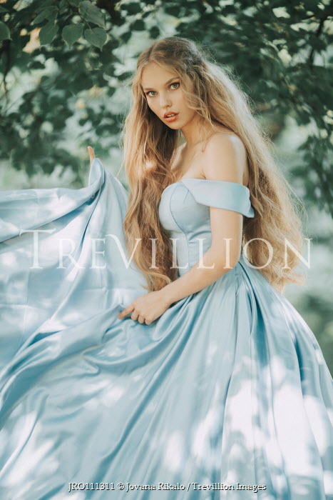 Jovana Rikalo young woman in ball dress with long blonde wavy hair Women