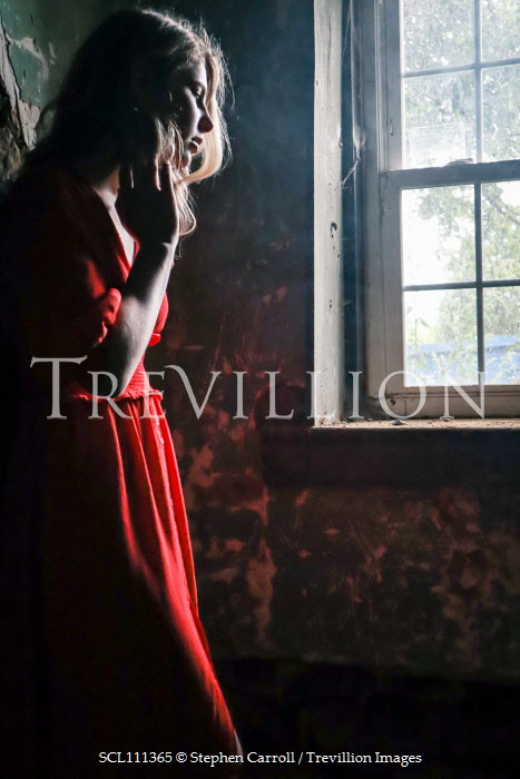 Stephen Carroll Young women in red looking through window Women