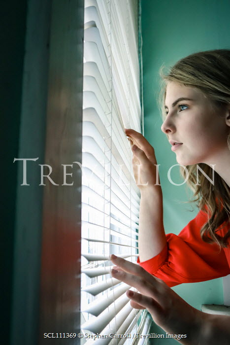 Stephen Carroll young women looking through blinds Women