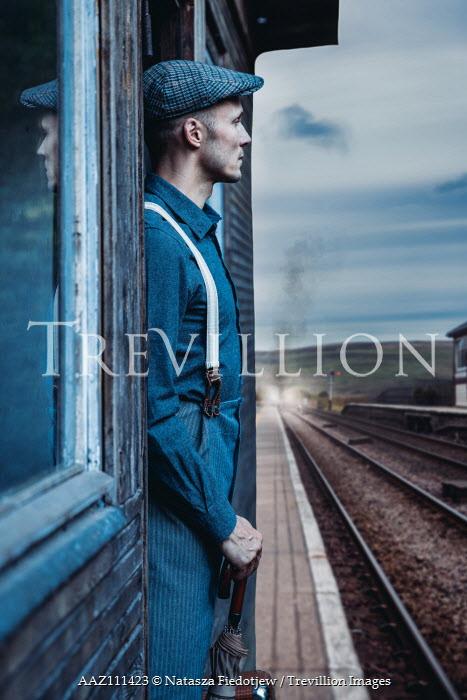Natasza Fiedotjew Vintage man waiting on steam train station Men