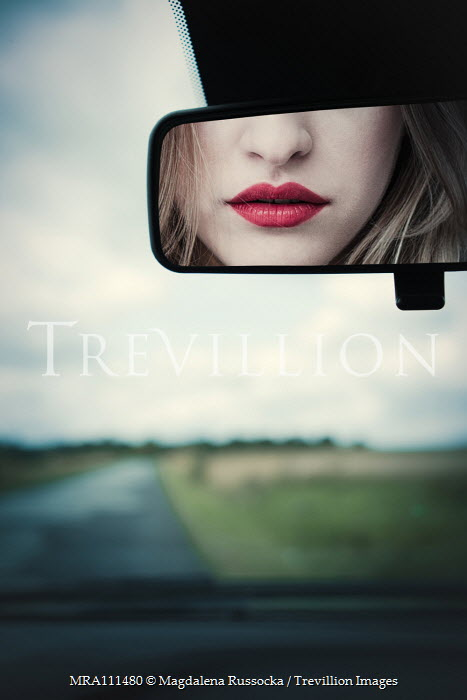 Magdalena Russocka red lips of woman reflected in car mirror