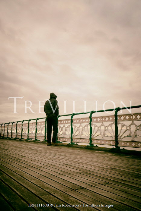 Tim Robinson Man in hooded jacket on pier