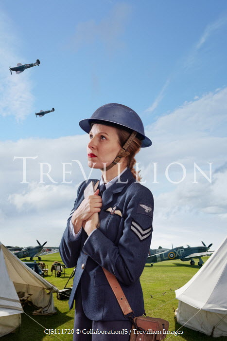CollaborationJS WOMAN IN UNIFORM CLUTCHING LETTER OUTDOORS Women