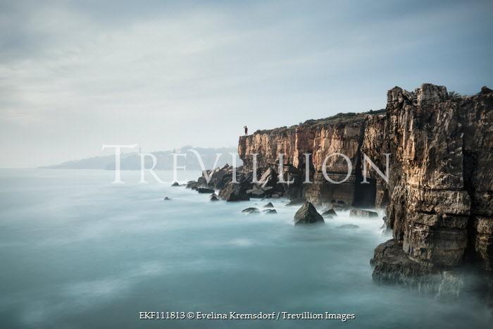 Evelina Kremsdorf MAN ON CLIFFS BY MISTY SEA Seascapes/Beaches