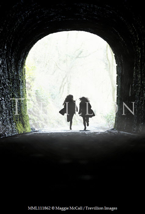 Maggie McCall Silhouette of women running in tunnel