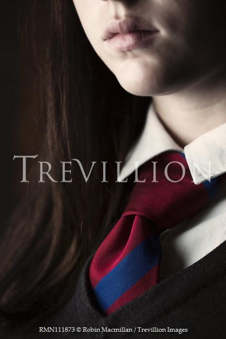 Robin Macmillan Close up of tie on girl's school uniform