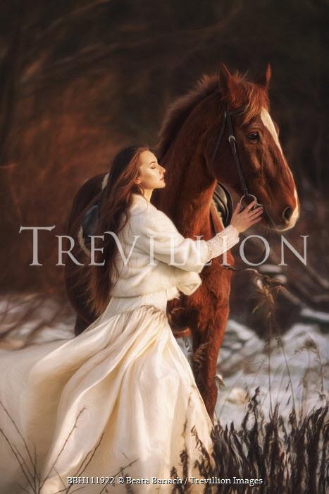 Beata Banach WOMAN WITH HORSE IN SNOWY COUNTRYSIDE Women