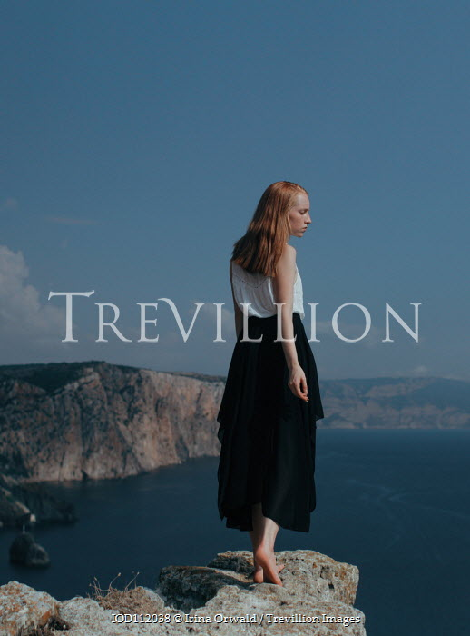 Irina Orwald GIRL WITH RED HAIR ON CLIFF WATCHING SEA Women