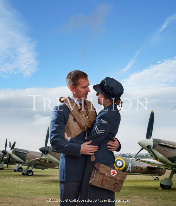 CollaborationJS A pilot  hugging his  girlfriend at a airfield Couples