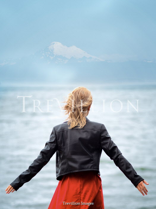 Elisabeth Ansley BLONDE WOMAN BY LAKE WITH SNOWY MOUNTAINS Women