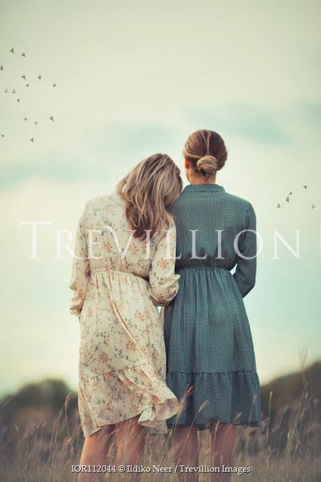 Ildiko Neer Two girls standing in field