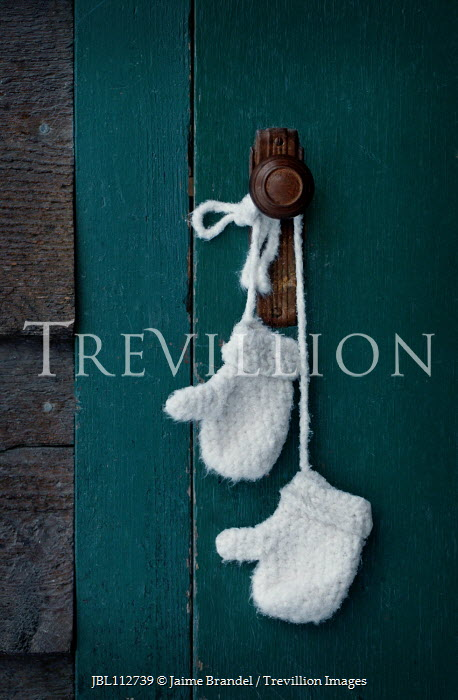 Jaime Brandel Child's mittens hanging from door knob