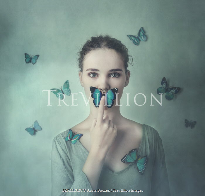Anna Buczek Young woman with blue butterfly on lips Women