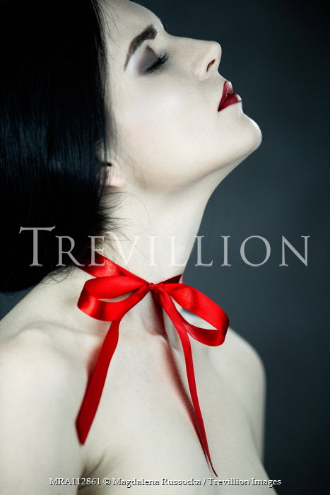 Magdalena Russocka woman with red ribbon tied around neck