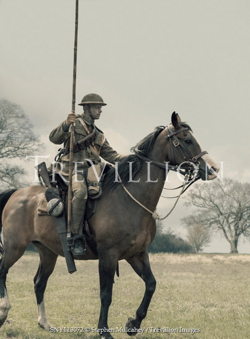 Stephen Mulcahey A ww1 mounted soldier riding through a field