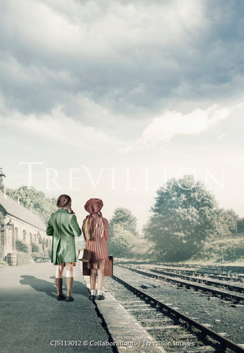 CollaborationJS Two  evacuee girls waiting at a train station