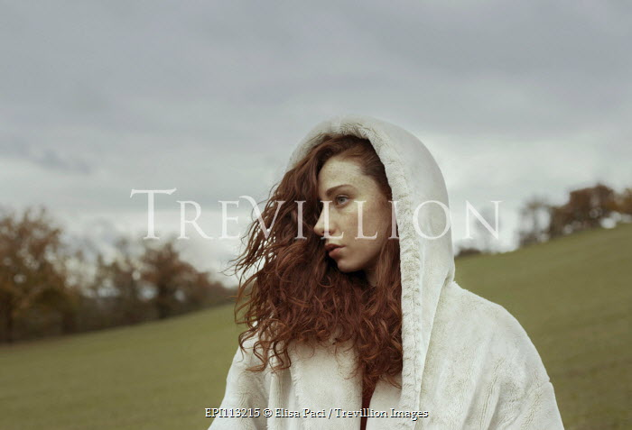 Elisa Paci Young woman in white hooded coat