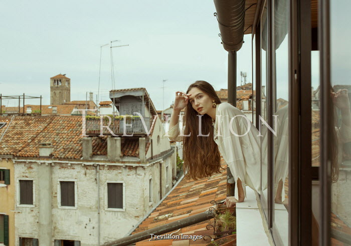 Elisa Paci Young woman leaning out window