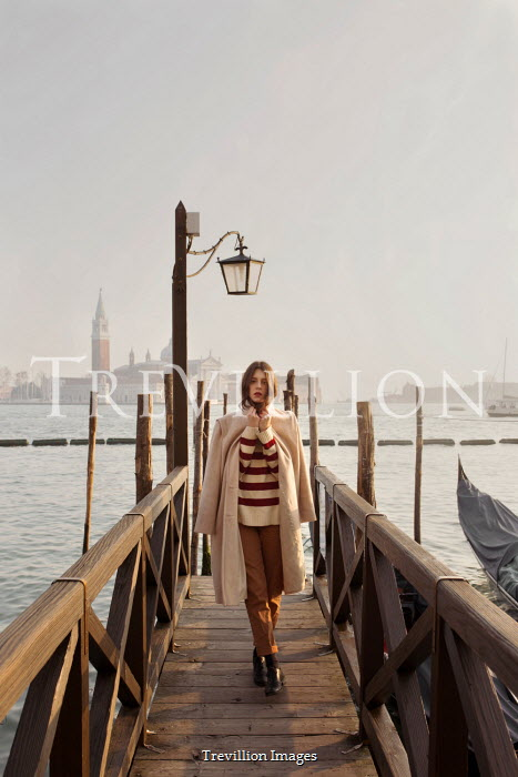 Elisa Paci Young woman on jetty in Venice, Italy