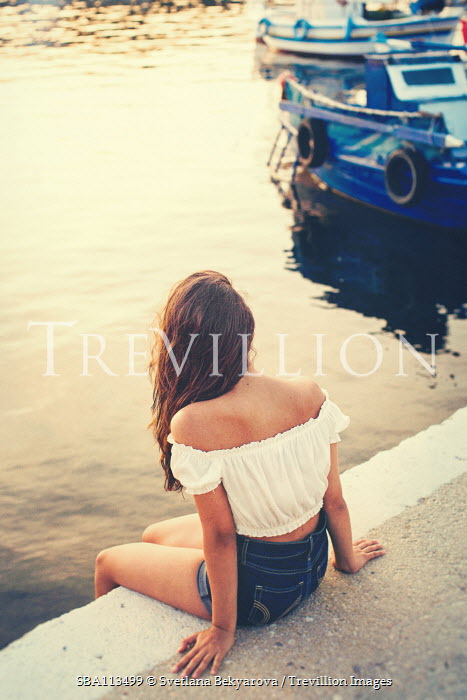 Svetlana Bekyarova young modern girl sitting by boat lake