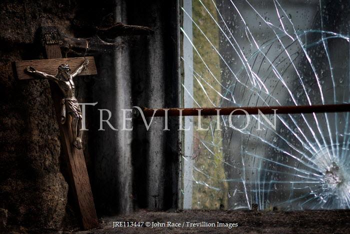 John Race Broken window and wooden crucifix