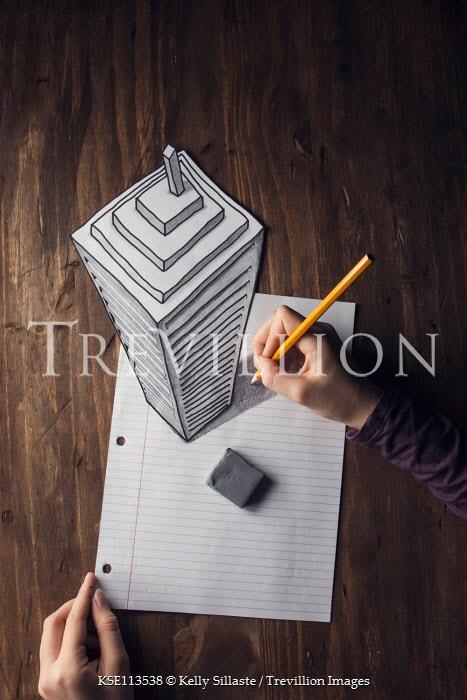 Kelly Sillaste Hands of woman drawing skyscraper