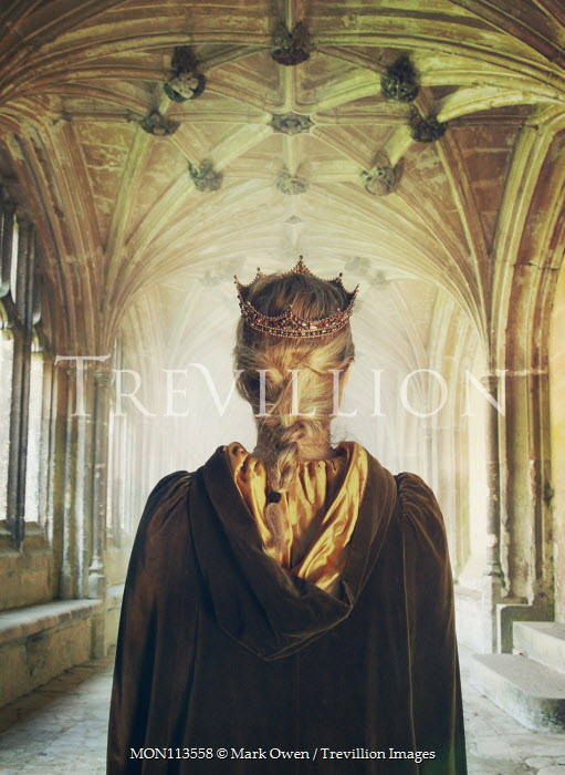 Mark Owen Young woman in Medieval cloak and crown in cloister