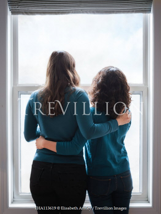 Elisabeth Ansley Friends standing by window