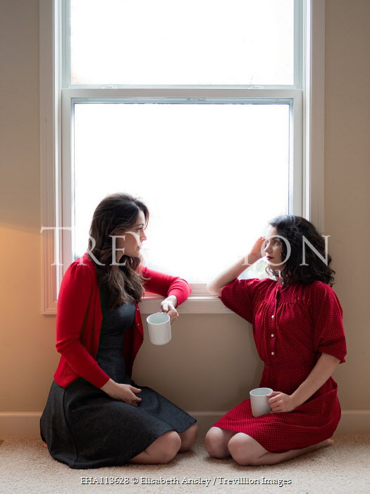 Elisabeth Ansley Friends with coffee cups by window